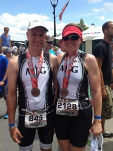 At the finish line at the 2013 Raleigh 70.3 (love my crooked hat!!)